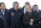 Vladimir Putin, Dmitry Rogozin and Igor Komarov (right to left)