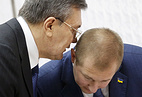 Victor Yanukovich (L) with his attorney, Vitaly Serdyuk (R)