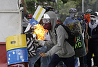 Demonstrators seen during clashes in Caracas, Venezuela