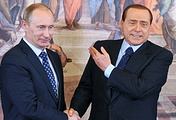 Vladimir Putin (left) and Silvio Berlusconi (right)