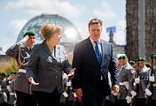 Angela Merkel and Maris Kucinskis