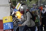 Demonstrators seen during clashes in Caracas, Venezuela