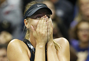 Maria Sharapova reacts after defeating Simona Halep of Romania