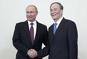 Russian President Vladimir Putin and Chinese Vice President Wang Qishan