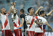 Argentina's River Plate players celebrate after defeating Brazil's Gremio during a semifinal second leg match of the Copa Libertadores