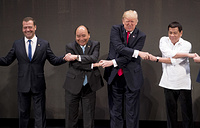 "US President Donald Trump does the ""ASEAN-way handshake"" with Russian Prime Minister Dmitry Medvedev, Vietnamese Prime Minister Nguyen Xuan Phuc and Philippine President Rodrigo Duterte during the opening ceremony at the ASEAN Summit in Manila, Philippines, 2017"