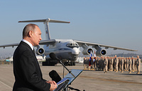 Russia's President Vladimir Putin addresses Russian forces at the Hmeymim air base. Putin ordered Russian troops to start pulling out of Syria, December 11, 2017