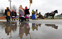 Local residents dressed in costumes take part in traditional Christmas carolling (known as Kolyada) in the village of Ivanova Sloboda, Belarus