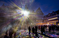 "Light shines out from one of the buildings at Roemer Square during the official opening of the ""Luminale"" light festival in Frankfurt, Germany, March 20"