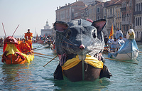 Boats sail during the water parade of 'Pantegana' (big mouse) part of the Venice Carnival, Italy
