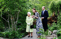 Britain's Queen Elizabeth, Catherine The Duchess of Cambridge and William, the Duke of Cambridge during a visit to the Adam White and Andree Davies co-designed 'Back to Nature' garden