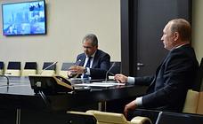 Russia's Defense Minister Sergei Shoigu and Russia's President Vladimir Putin