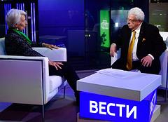 Управляющий директор Международного валютного фонда Кристин Лагард и первый заместитель генерального директора ТАСС Михаил Гусман