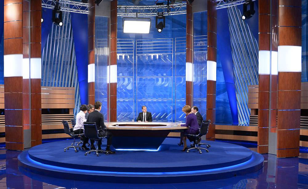 Russian Prime Minister Dmitry Medvedev answers questions of five Russian TV channels