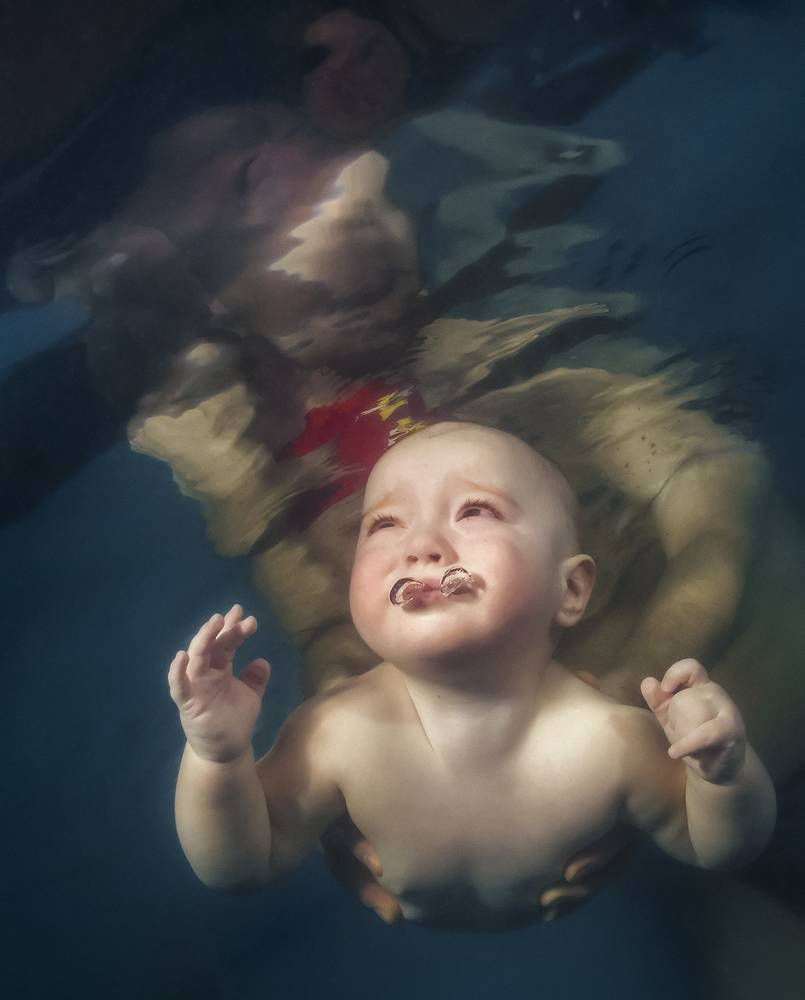A child in a Kiev swimming pool, where kids as young as three months old are given swimming lessons. March 13, 2013.
