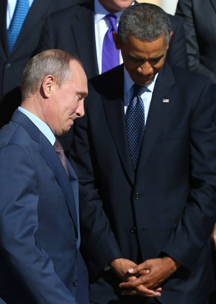 Russia's President Vladimir Putin and U.S. President Barack Obama at the collective photo session with members of the G20 summit. September 6, 2013.