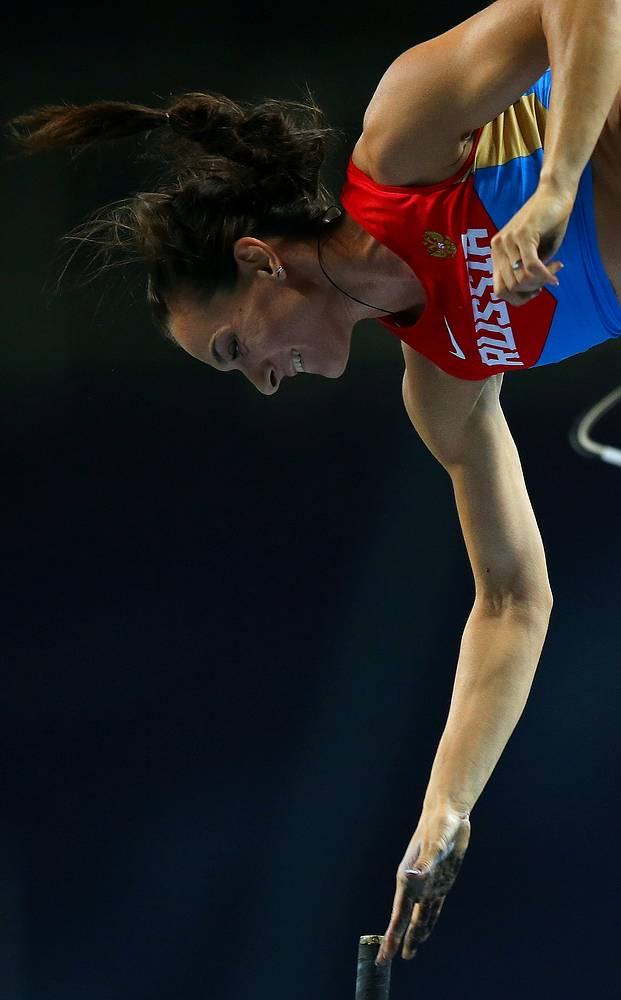 Yelena Isinbayeva wins championship title in the pole jump at home at Luzhniki stadium