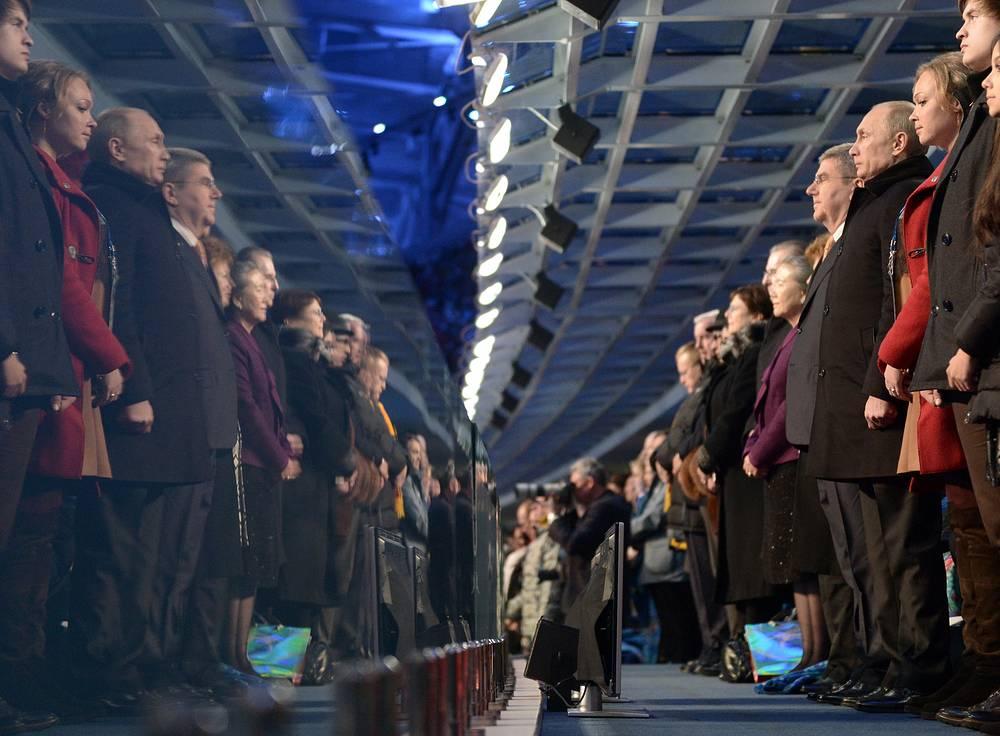 Russia's President Vladimir Putin bobsleigh racer Irina Skvortsova, and IOC president Thomas Bach attend the opening ceremony of the Sochi