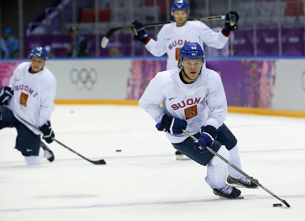 Finland forward Mikael Grandlund runs through a drill during a training session at the Bolshoy Ice Dome