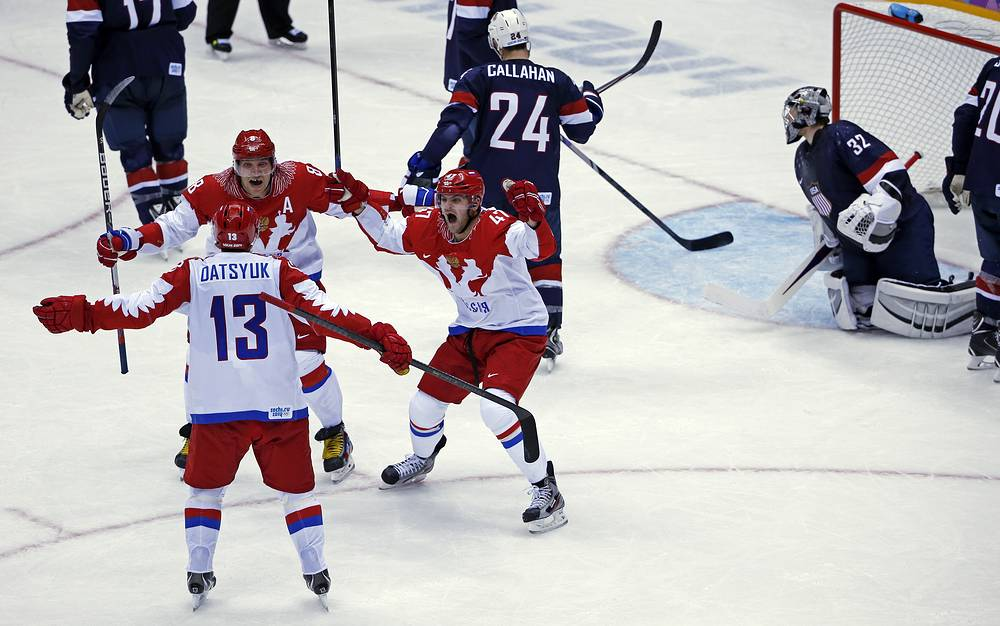 Russia forward Pavel Datsyuk, forward Alexander Ovechkin and forward Alexander Radulov react after Datsyuk's third period goal
