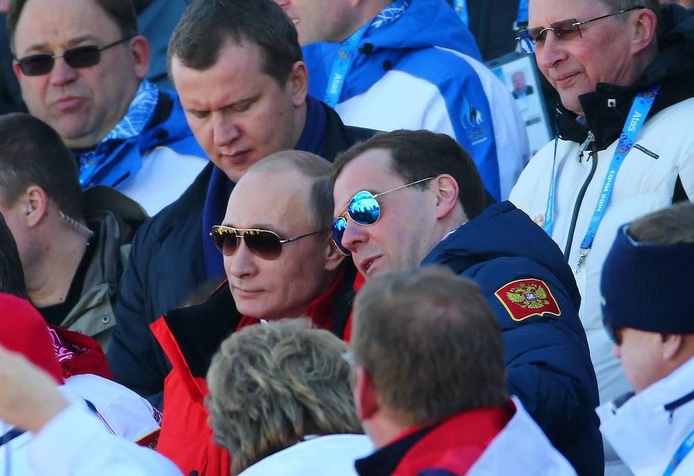 Russian Prime Minister Dmitry Medvedev (C-R) and Russian President Vladimir Putin