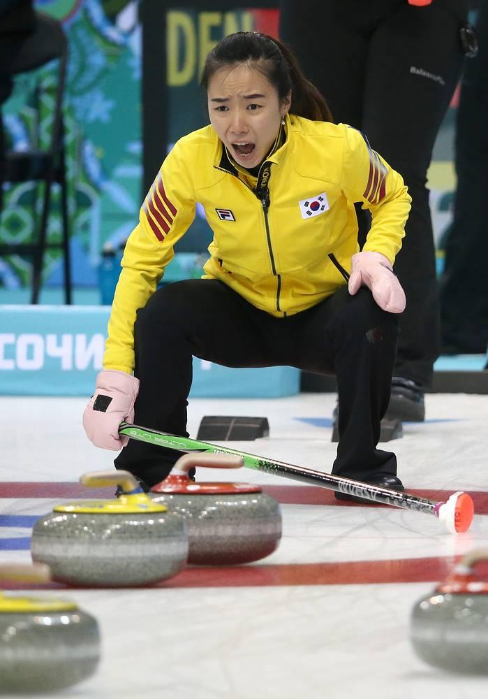 Kim Jisun of Korea reacts during the curling match between Denmark and Korea