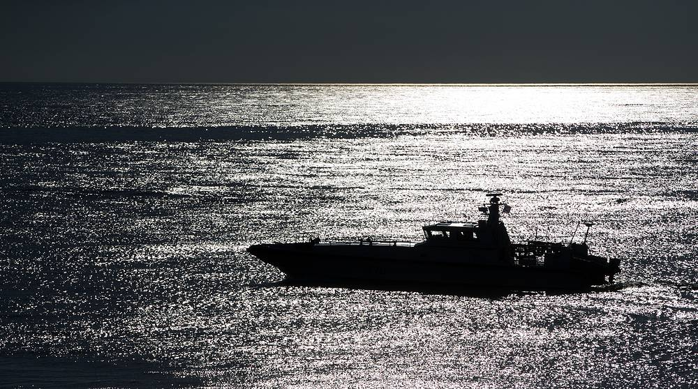 A Russian coast guard vessel patrols in the Black Sea off a beach in Sochi