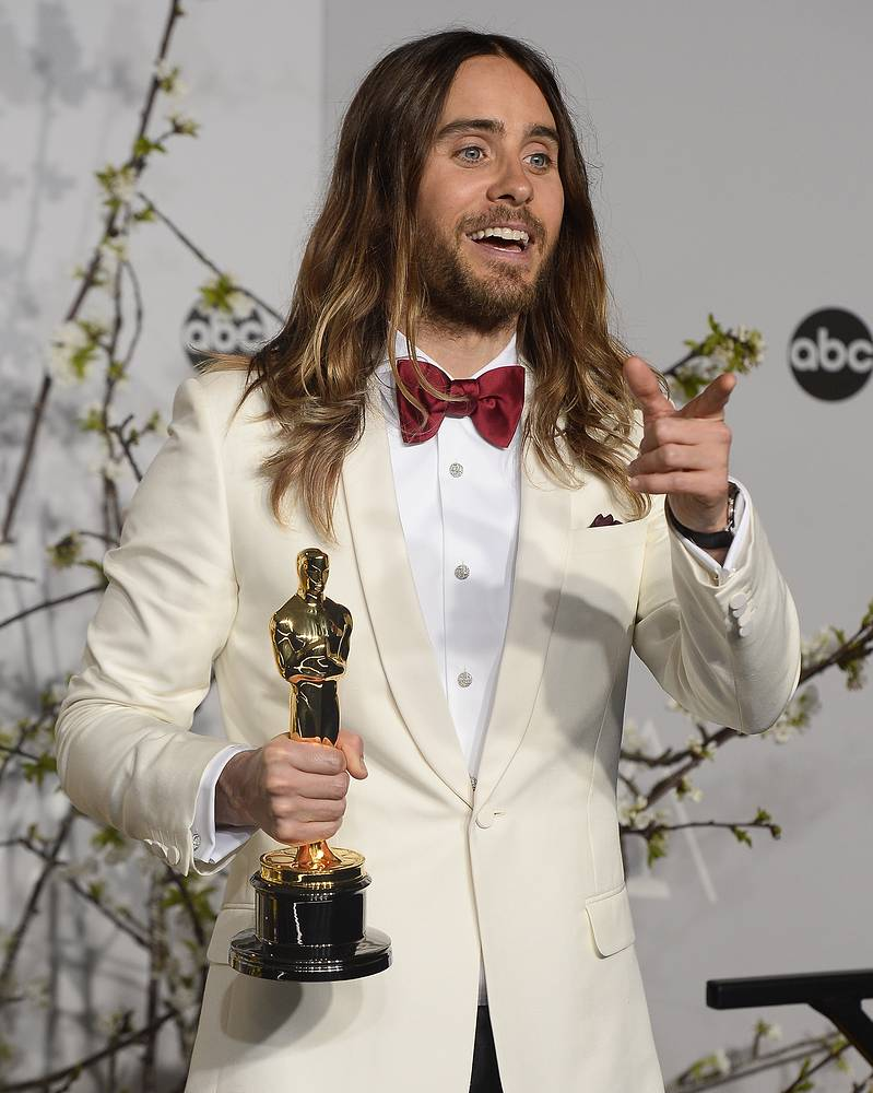 US actor and singer Jared Leto holds the award for Best Performance by an Actor in a Supporting Role for 'Dallas Buyers Club'
