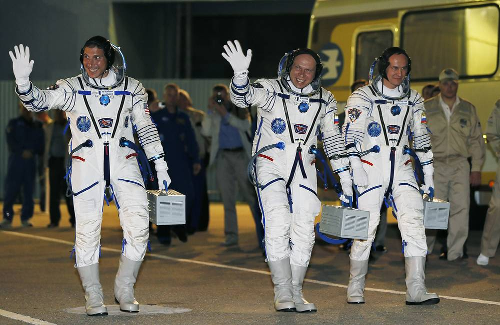 Sergey Ryazanskiy (R), Oleg Kotov (C) and NASA astronaut Mike Hopkins before taking off to the International Space Station (ISS) in September 2013