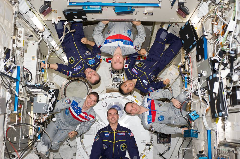 Clockwise from top center: Russian cosmonaut Oleg Kotov, commander; Japan Aerospace Exploration Agency astronaut Koichi Wakata, Russian cosmonaut Sergey Ryazanskiy, NASA astronauts Rick Mastracchio and Mike Hopkins, and Russian cosmonaut Mikhail Tyurin, all flight engineers