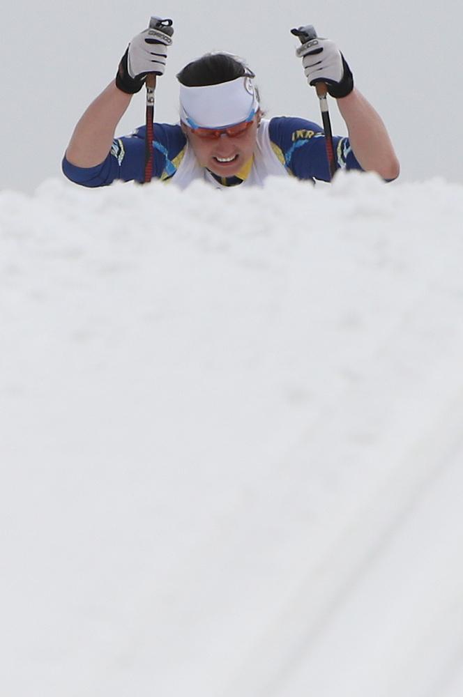 Ukraine's gold medallist Lyudmyla Pavlenko (114) competes in the classic 12km race
