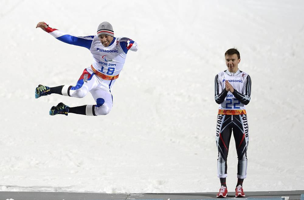 Gold medalist Alexey Bugaev (R) of Russia and silver medalist Vincent Gauthier-Manuel of France celebrate on the podium after Men's Alpine Skiing slalom standing race