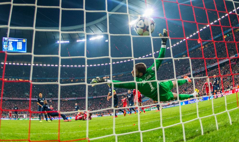 Thomas Muller of Bayern (not in picture) scores the 2-1
