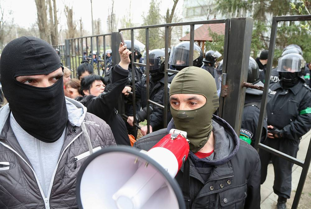 Protesters attend a rally near the district court in Kharkiv