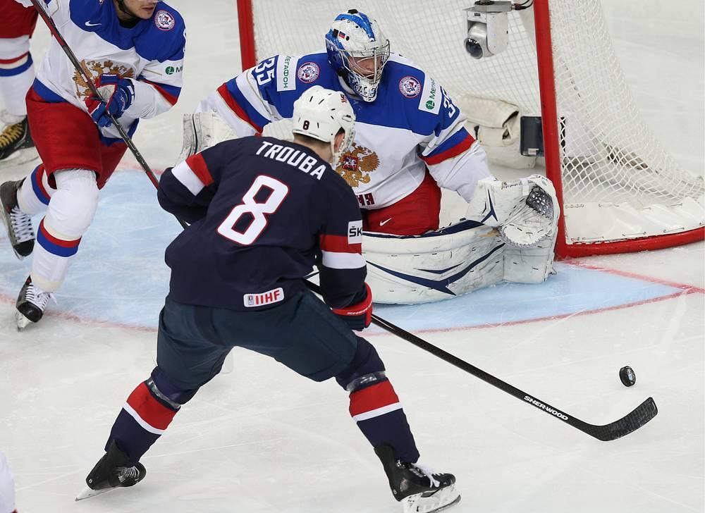 US Jacob Trouba (front) and Russia's goalie Andrei Vasilevsky