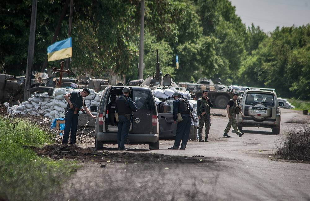 Ukrainian soldiers stand guard at a checkpoint not far from Sloviansk