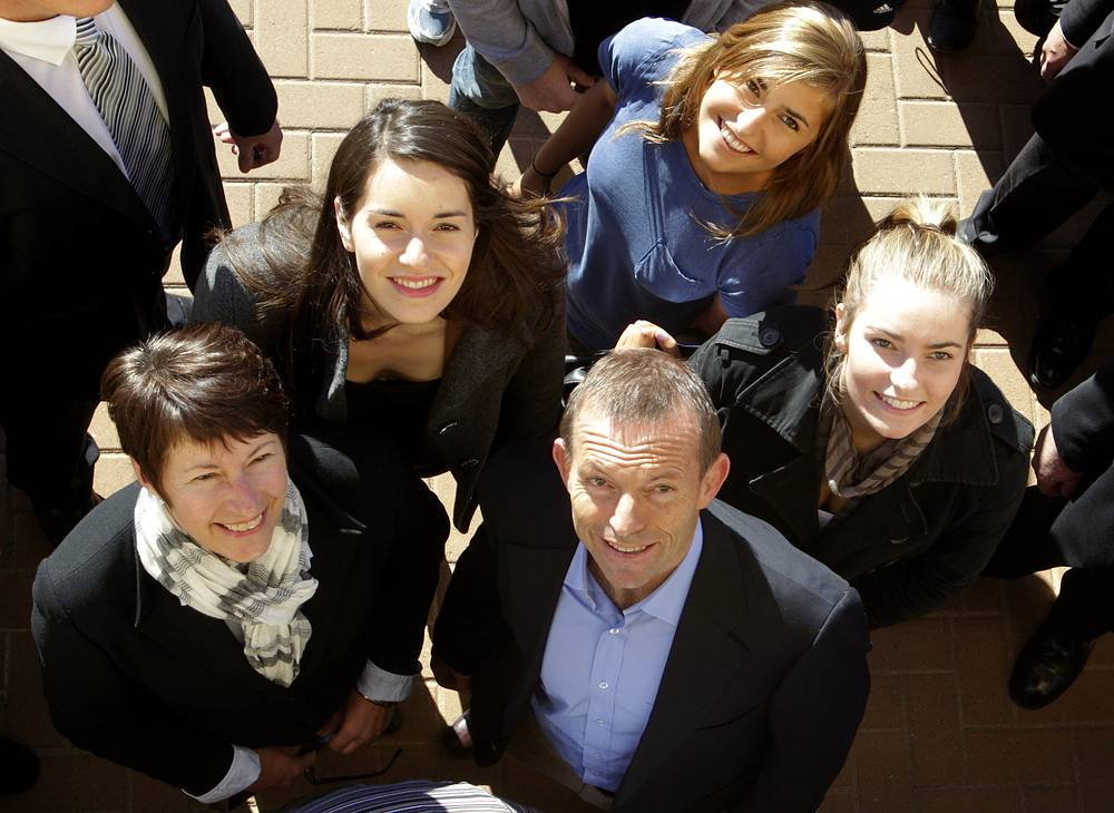 Australian Prime Minister Tony Abbott, bottom center, with his wife Margie, left, and daughters, from 2nd left to right, Louise, Frances and Bridge