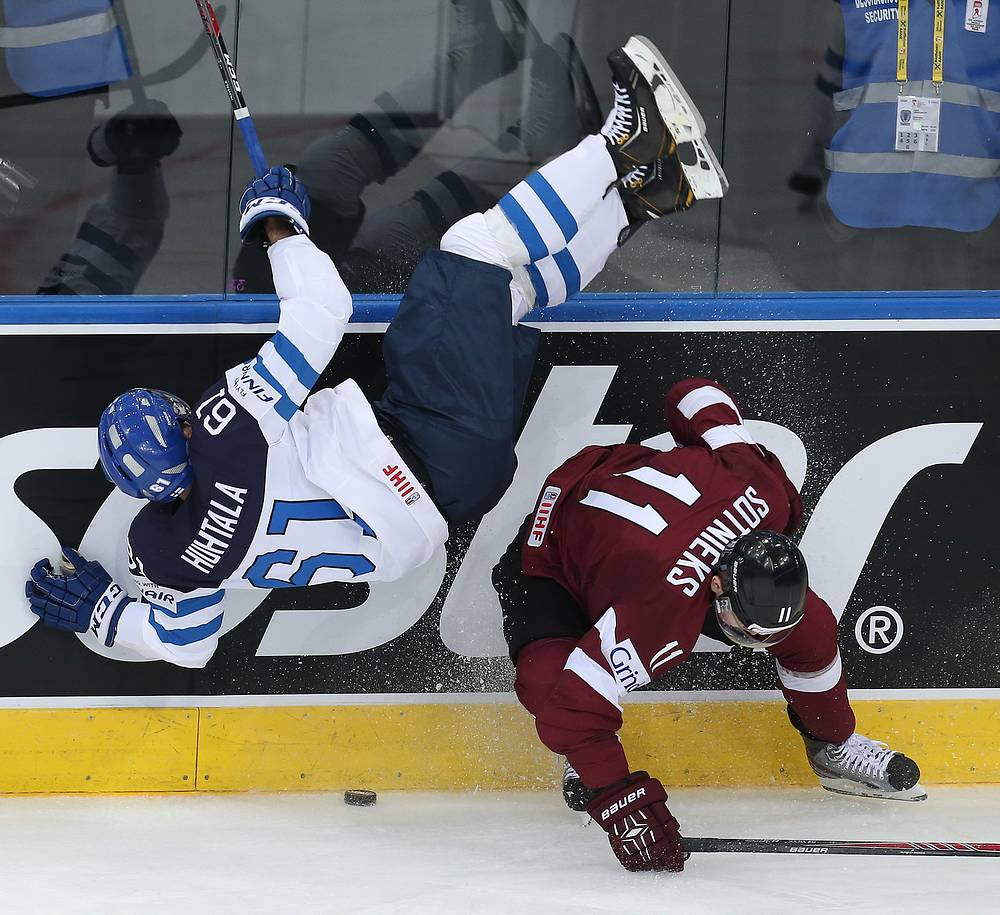 Finland's Tommi Huhtala (L) and Latvia's Kristaps Sotnieks