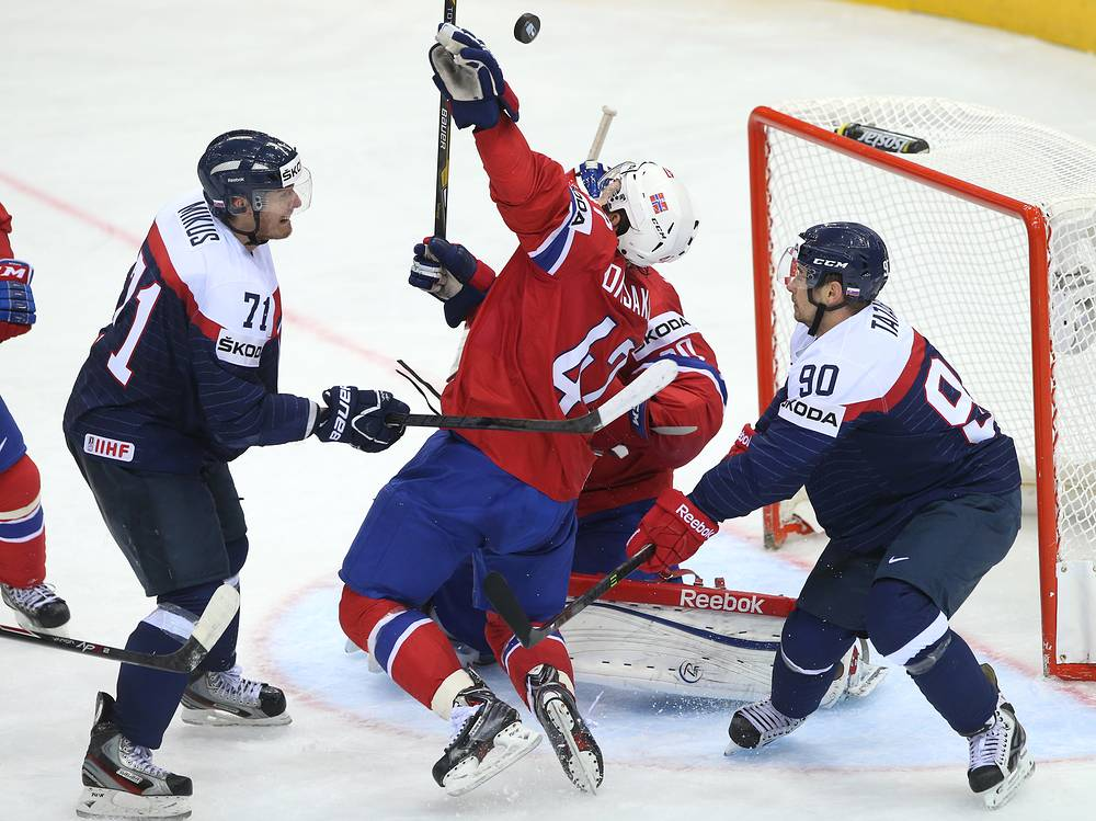 Alexander Bonsaksen (C) of Norway in action against Tomas Tatar (R) and Juraj Mikus (L) of Slovakia