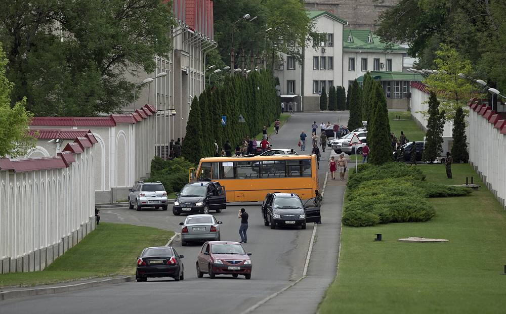 Gunmen use a minibus to block a road outside an entrance to the residence of Ukrainian metals tycoon Rinat Akhmetov