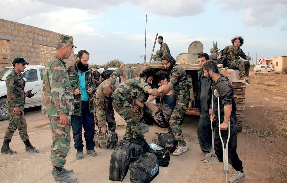 Syrian soldiers near Aleppo prison