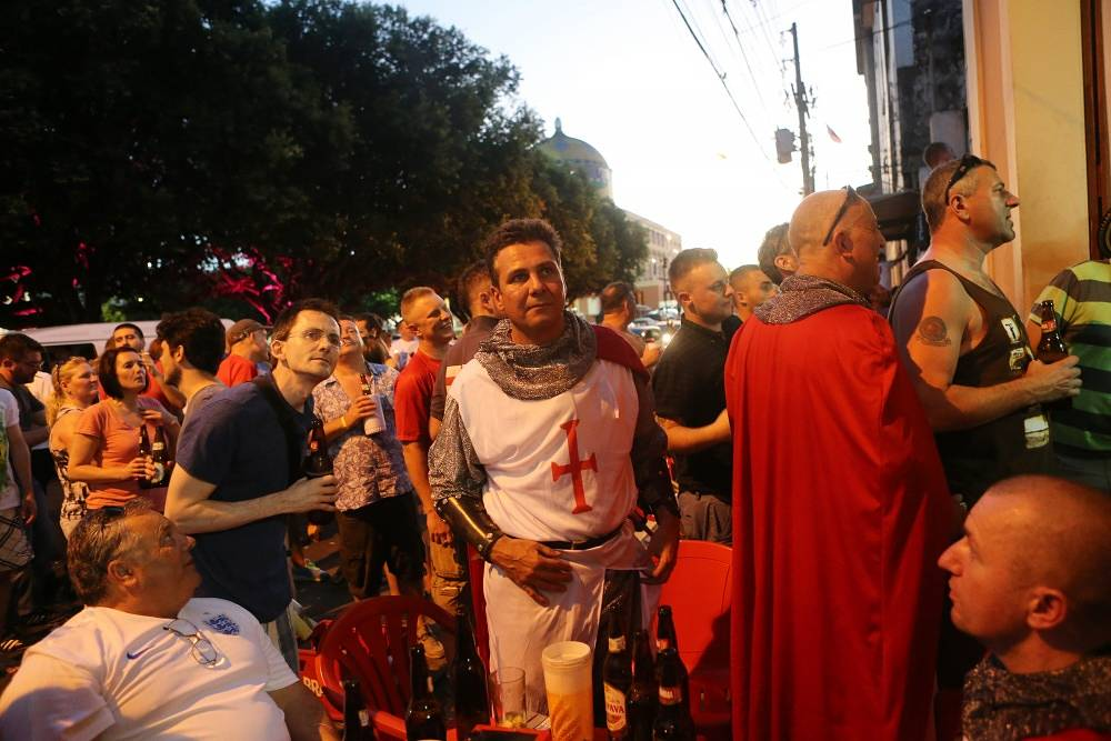 Englad supporter (center) watches football in Manaus, Brazil