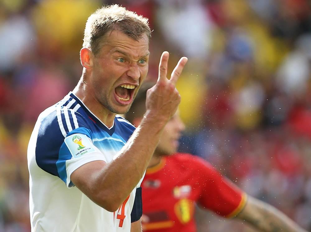 Russia's Vasily Berezutskiy reacts agrily