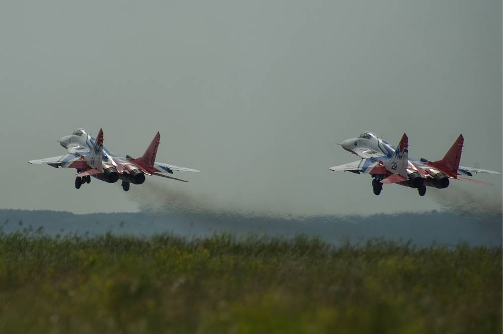 The Strizhi (Swifts) aerobatic team performs at Wings of Parma 2014 air show