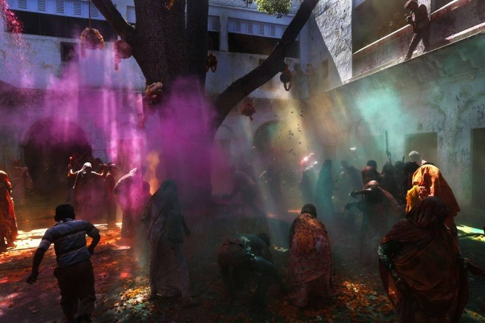 In late February - early March Indians celebrate Holi. People wear bright colorfull clothes and splash colored water