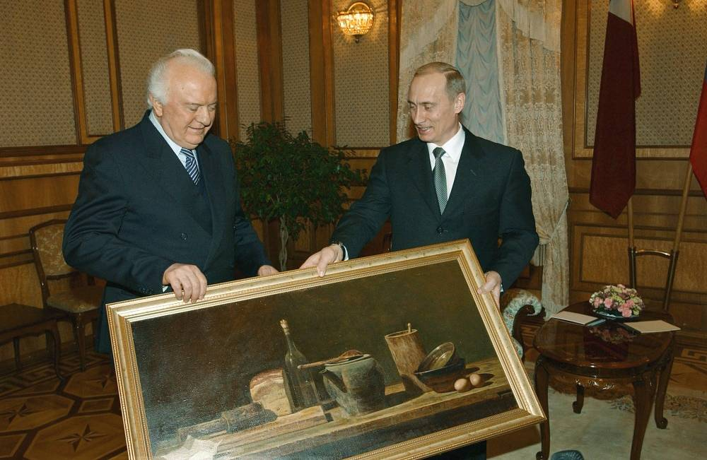 Russian President Vladimir Putin congratulates Eduard Shevardnadze on his 75th birthday
