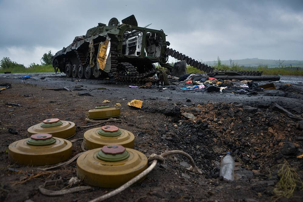 Landmines lie next to a destroyed military tank in Sloviansk