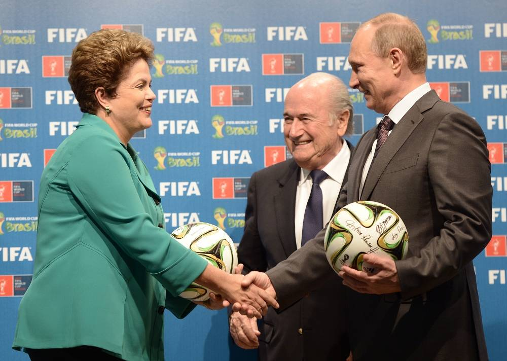 Brazilian President Dilma Rousseff, Sepp Blatter and Vladimir Putin during ceremony of passing the baton of World Cup's hosting nations to Russia