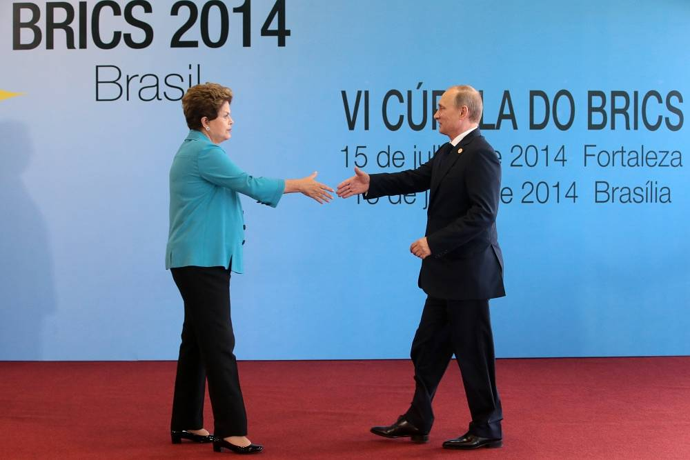 Brazilian President Dilma Rousseff and Russia's Vladimir Putin meet before start of the BRICS forum in Fortaleza