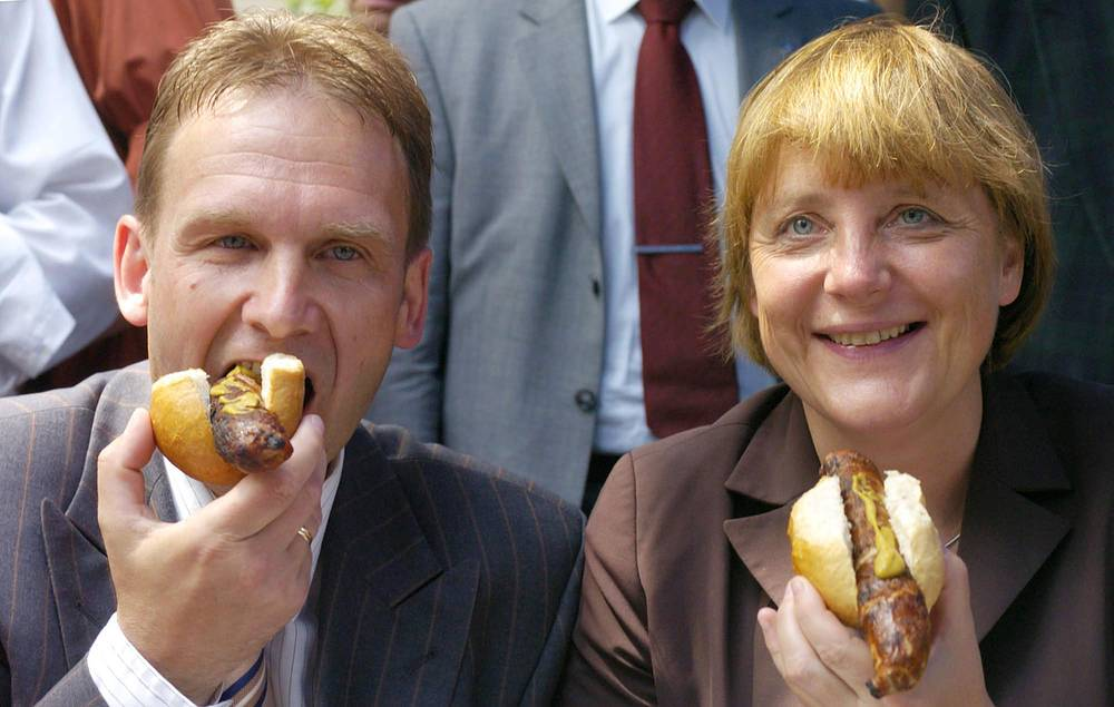 Angela Merkel (right) with a hotdog during her election campaign in 2004